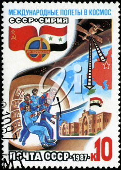 USSR - CIRCA 1987: A post stamp printed in USSR divided to international Soviet Syrian space flights, circa 1987