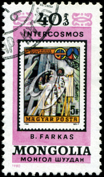 MONGOLIA - CIRCA 1980: A stamp printed in Mongolia showing stamp with cosmonaut B. Farkas, circa 1980