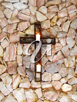 Royalty Free Photo of a Mounted Cross With Candles