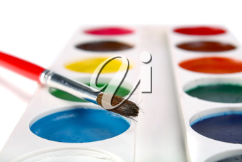 brush and paints isolated on white background