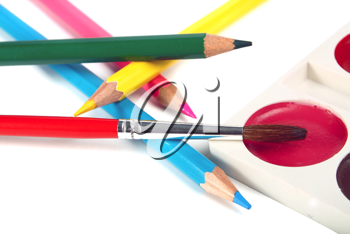 crayons coloured pencils and brush for paints isolated on white background