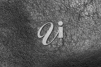 Black leather as a background. close-up