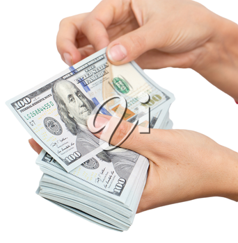 Dollars in hand on a white background