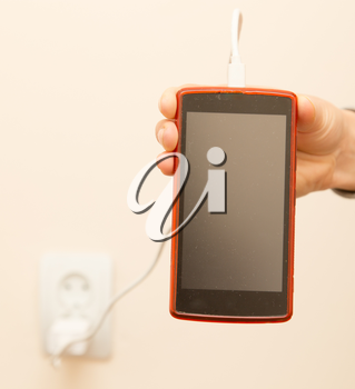 cell phone charging in your hand