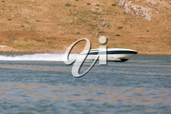 Boat floats on the lake speed
