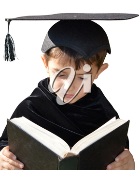 Little boy with academic hat reads a book on a white background