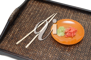 Royalty Free Photo of a Plate and Chopsticks on a Tray