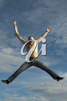 Royalty Free Photo of a Man Jumping in the Air