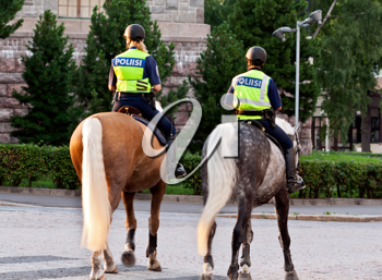Royalty Free Photo of Two Female Police Officers on Horses in Helsinki, Finland