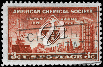 Royalty Free Photo of 1951 US Stamp Shows the American Chemical Society Emblem and Symbols of Chemistry, AMC Issue