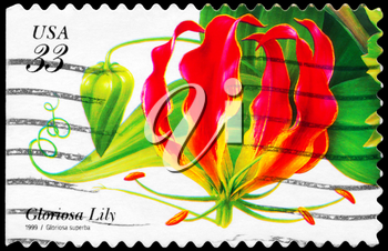 Royalty Free Photo of 1999 US Stamp Shows the Gloriosa Lily (Gloriosa Superba), Tropical Flowers