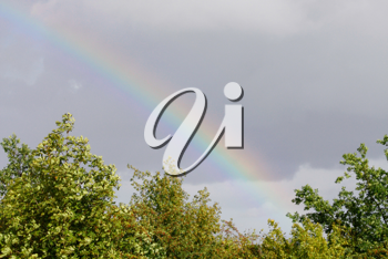 Royalty Free Photo of a Rainbow in the Sky