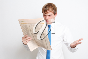 Royalty Free Photo of a Businessman Reading the News