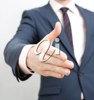Royalty Free Photo of a Person Reaching for a Handshake