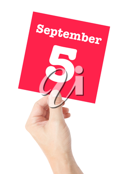September 5 written on a card held by a hand