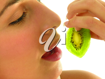 Royalty Free Photo of a Woman With a Kiwi