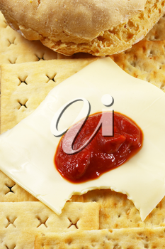 bread ,crackers and cheese with tomato sauce