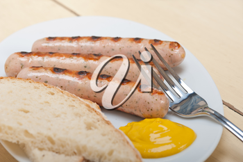 traditional fresh German wurstel sausages grilled with yellow mustard