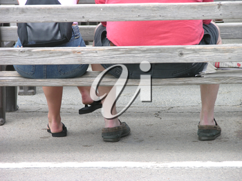 Royalty Free Photo of People Sitting on a Bench