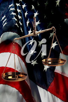 Royalty Free Photo of the Scales of Justice and an American Flag