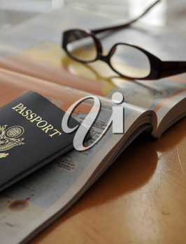 Royalty Free Photo of a Passport and Map