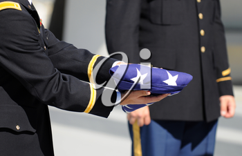 Royalty Free Photo of a Military Honor Guard Soldier Holding a Flag