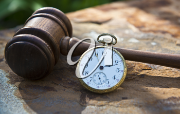 Royalty Free Photo of a Gavel and Pocket Watch