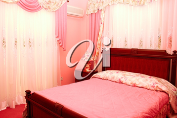 Royalty Free Photo of a Pink Bedroom