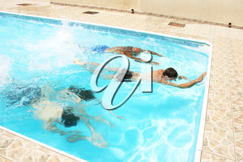 Royalty Free Photo of People Swimming in a Pool