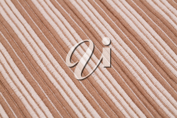 Brown and white knitted cloth as a background.