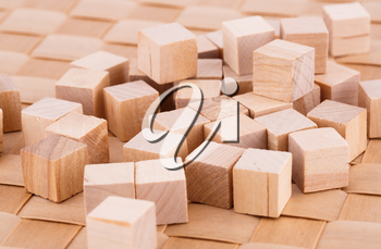 Wooden cubes on bamboo background.
