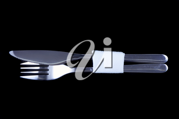 Table serving-knife,plate,fork on  various colour background.
