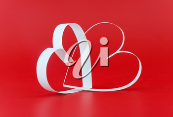 St. Valentine Day. Two hearts,on red background.