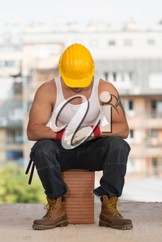 Construction Worker Relaxing The Fresh Air During Work