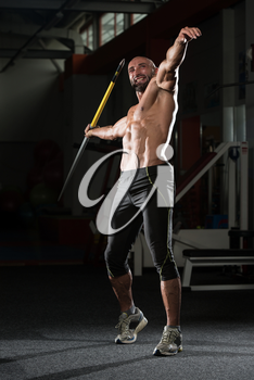 Mature Man Athlete Practicing To Throw A Javelin