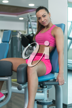 Leg Exercises Close Up -  Young Woman Doing Leg With Machine In Gym