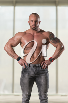 Portrait Of A Young Physically Fit Tattoo Man Showing His Well Trained Body - Muscular Athletic Bodybuilder Fitness Model Posing After Exercises