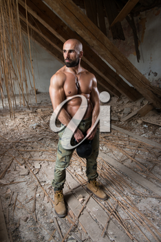Man Working Out With Kettle Bell In Shelter - Bodybuilder Doing Heavy Weight Exercise With Kettle-bell