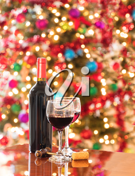 Red wine on Mahoney table for holiday celebration.