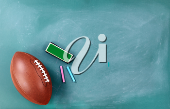 American football on cleaned chalkboard with eraser and chalk