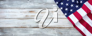 United States flag on white rustic wooden background with plenty of copy space