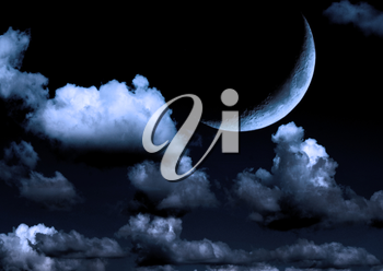 The moon in the night sky in clouds