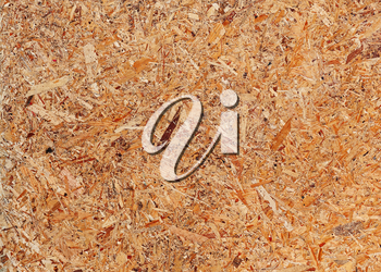 Recycled compressed wood chipboard. Useful for designers as background. Closeup.