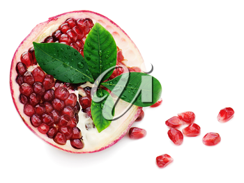 Pomegranate fruit with green leaves isolated on white background.
