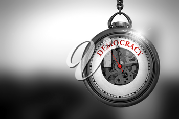 Democracy Close Up of Red Text on the Pocket Watch Face. Democracy on Vintage Pocket Clock Face with Close View of Watch Mechanism. Business Concept. 3D Rendering.