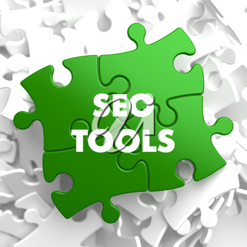 SEO Tools on Green Puzzle on White Background.