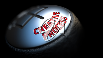 Creative Process - Red Text on Car's Shift Knob on Black Background. Close Up View. Selective Focus.