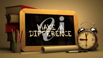 Make a Difference - Chalkboard with Hand Drawn Text, Stack of Books, Alarm Clock and Rolls of Paper on Blurred Background. Toned Image.