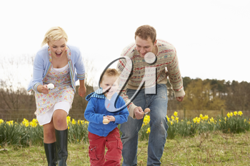 Family Having Egg And Spoon Race