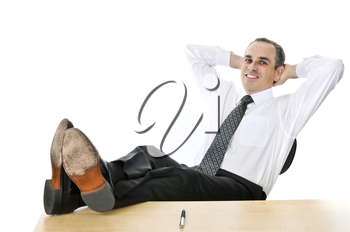 Relaxing businessman with feet up on his desk